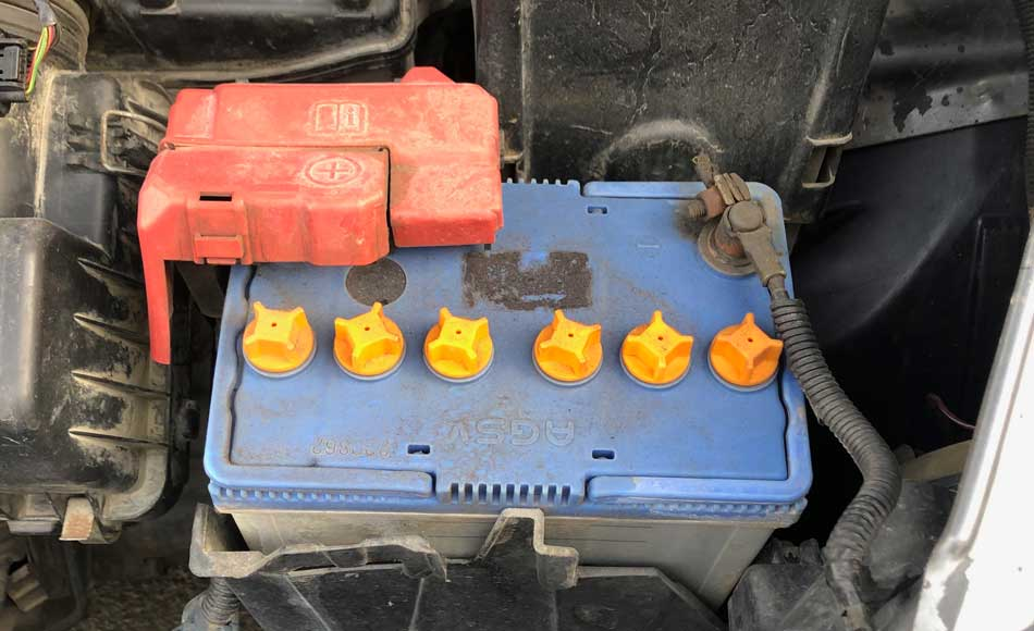 red terminal on the car battery